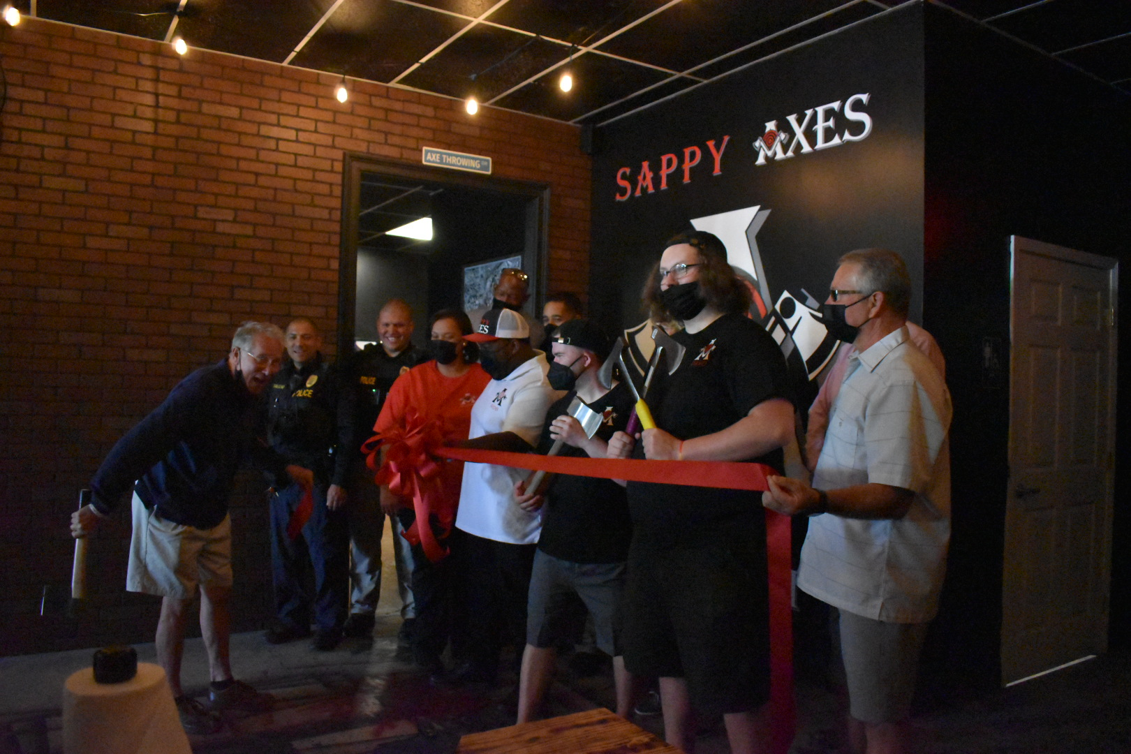 Image of Ribbon cutting at Sappy Axes