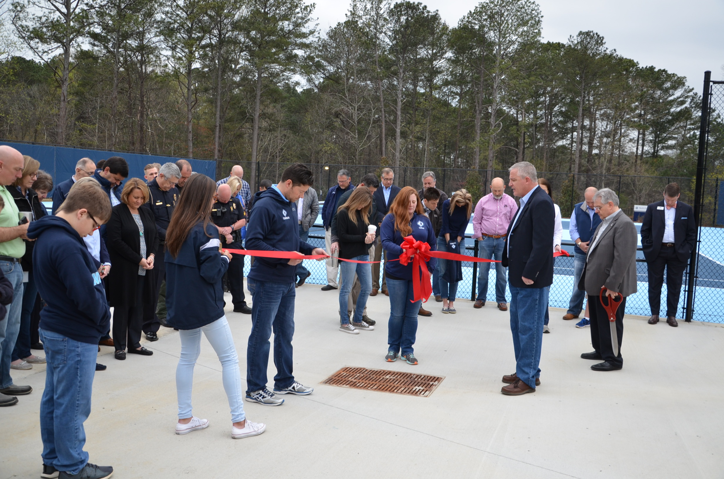 Image of ribbon cutting at Tennis Courts