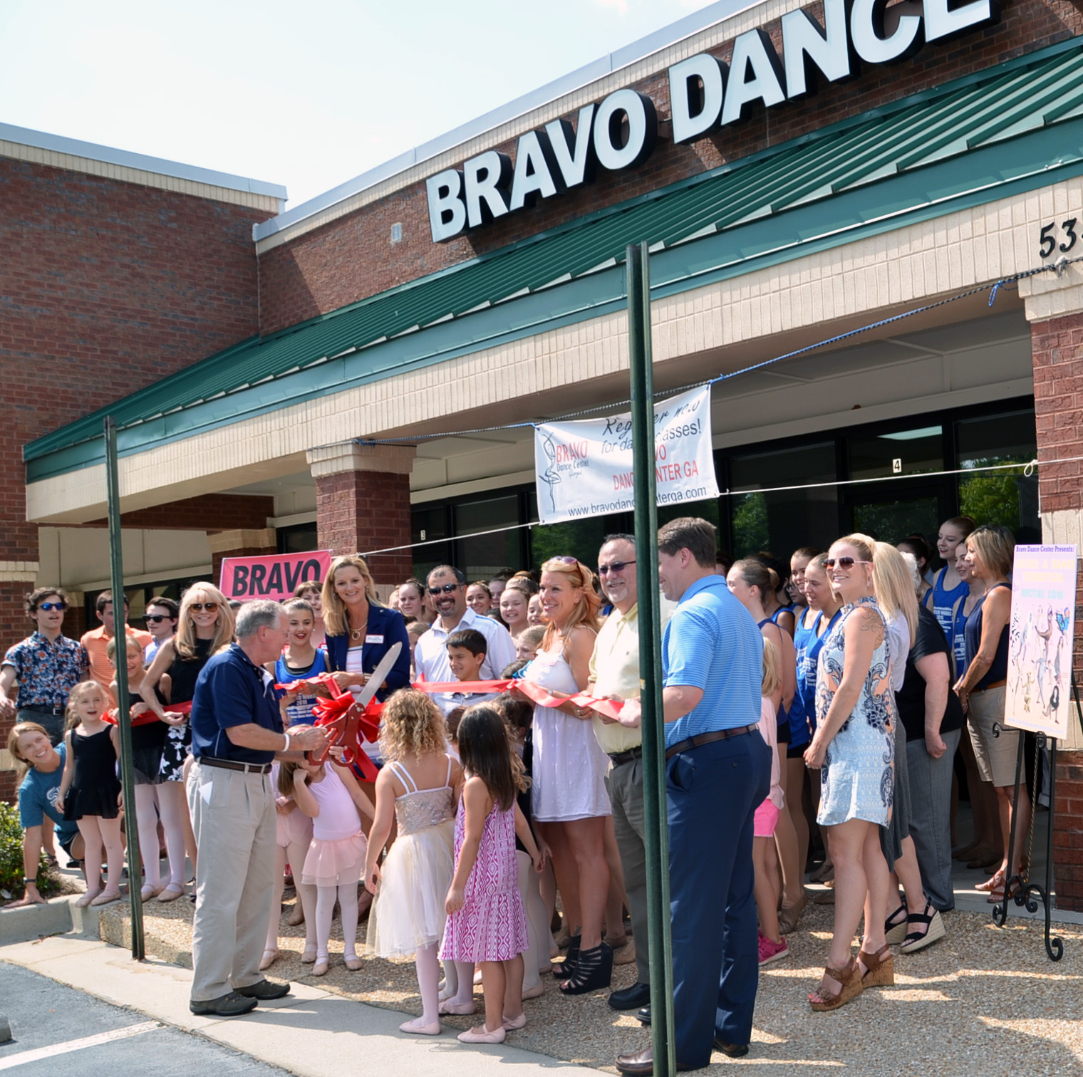 Ribbon cutting Bravo