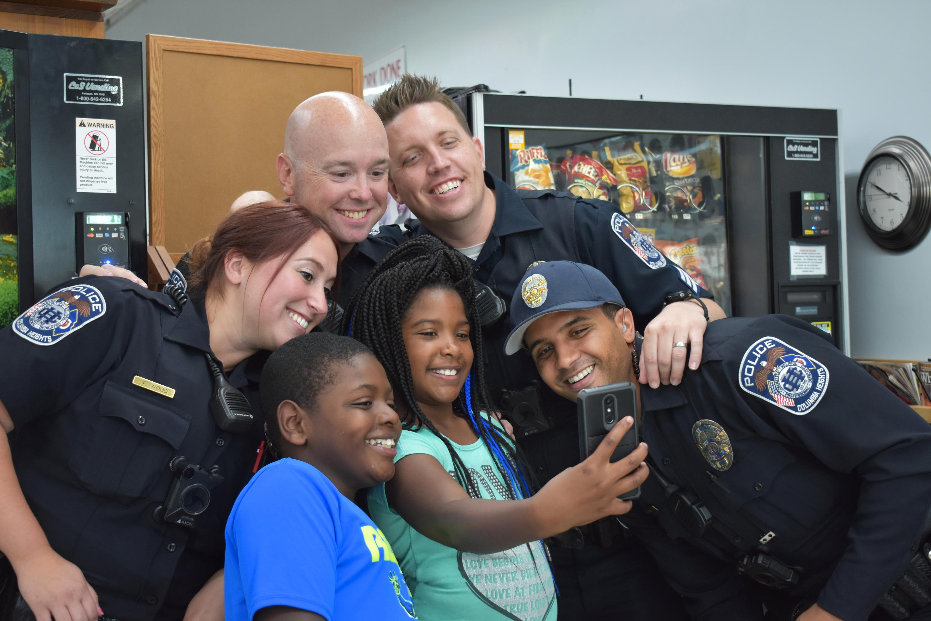 Cuts with a Cop Group Selfie with De'aria Roduez (4th grader) and brother