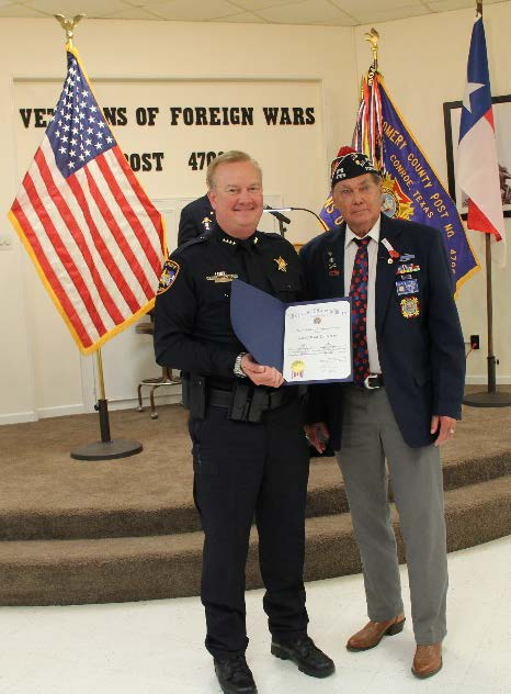 Photo of Sheriff Rand Henderson receiving recognition from VFW Post Commander