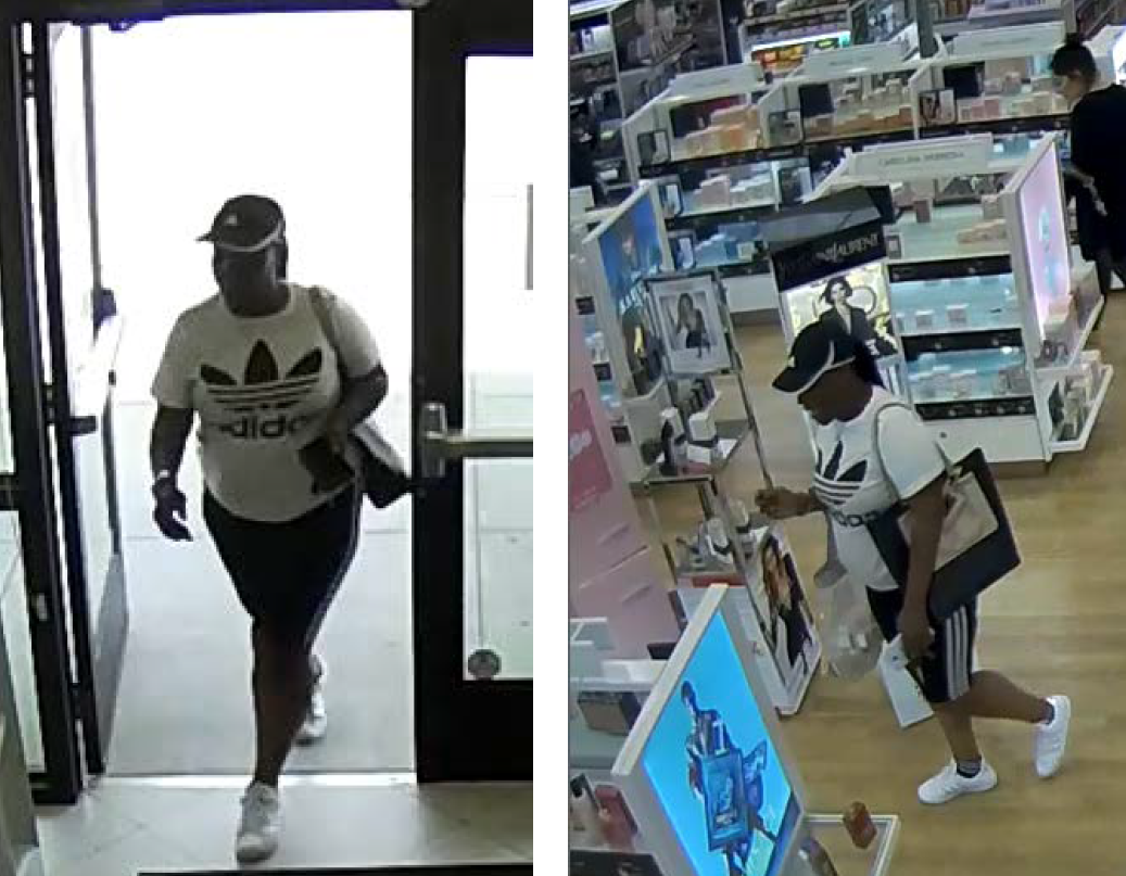 Ulta theft female suspect wearing black and white Adidas ballcap, white t-shirt with large Adidas logo, and black leggings with Adidas stripes and white shoes. Suspect is carrying a large black purse with tan detail and a white cellphone.