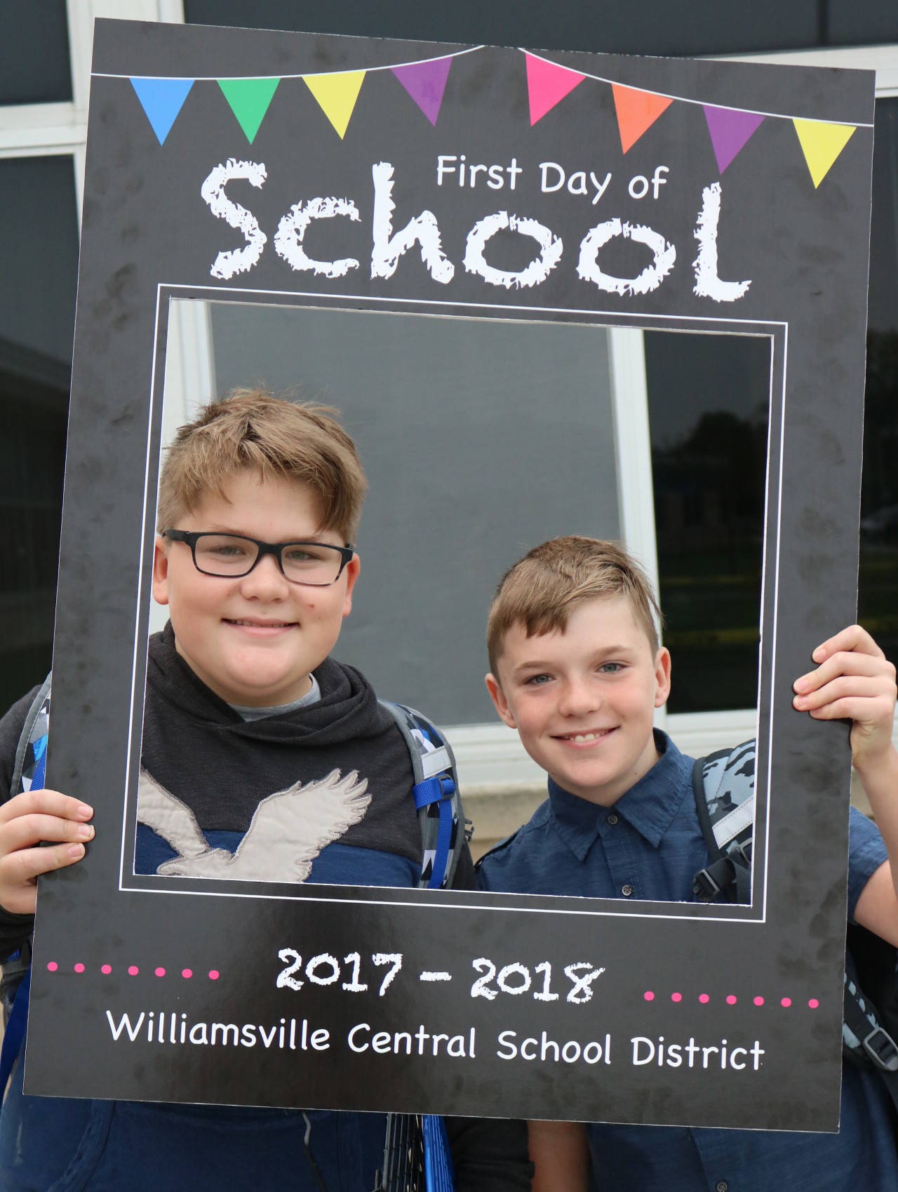 Middle school students hold photo frame